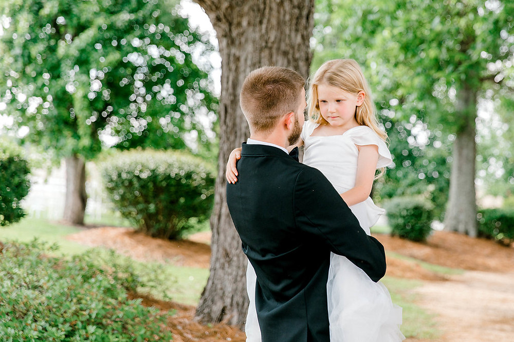 Groom and Flower Girl (c) MorganLeighPhoto