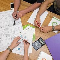 Karves Eneron Services plans on a desk