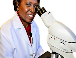 Wastewater Microbiologist Toni Glymph-Martin with microscope