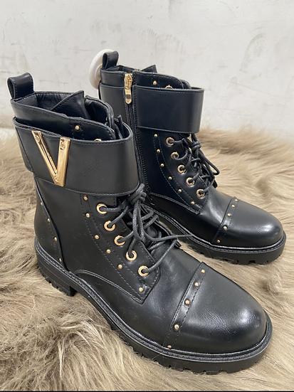boots avec boucles dore