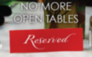 Table with no more open tables and reserved sign.