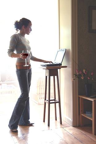 Girl making online restaurant reservation on her laptop