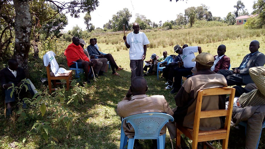 Community Leader engaging with men to create a more enabled environment to allow the woman in the community to access family planning services.