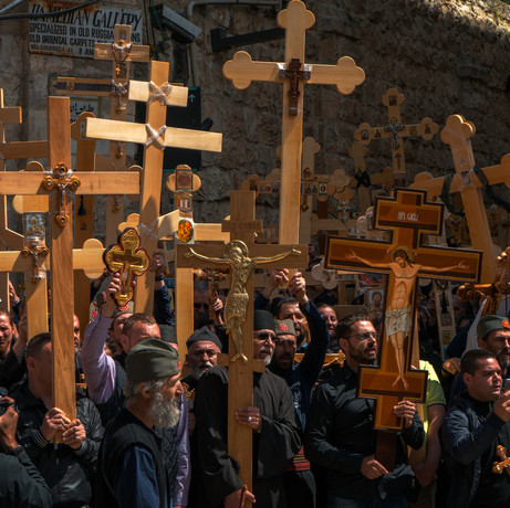 I am intrigued by the impact of faith on the believers.  I visited the Church of the Holy Sepulcher in Jerusalem many times and took photos of pilgrims kneeling and praying on the Stone of Anointing, which tradition believes to be where Jesus' body was prepared for burial, and  next to or inside the Aedicula, which encloses the Holy Sepulcher, where Jesus is said to have been buried and resurrected.  I tried to capture the spiritual, contemplative and reflective mood of the pilgrims facing  The tomb.  I love Chiaroscuro as used by Rembrandt and Caravaggio. The only light source inside the Aedicula is a candle. It enabled me to produce Chiaroscuro images, in which only the pilgrims are illuminated, so attention is not distracted, and which gives them a 3-dimensional shape and a sense of volume.