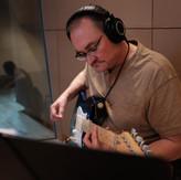 Mike tracking guitars at Paragon recording studios.