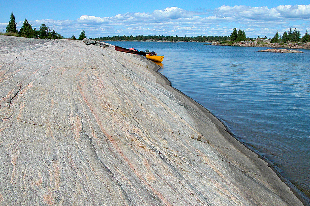 Large rock w_ canoes. Summer