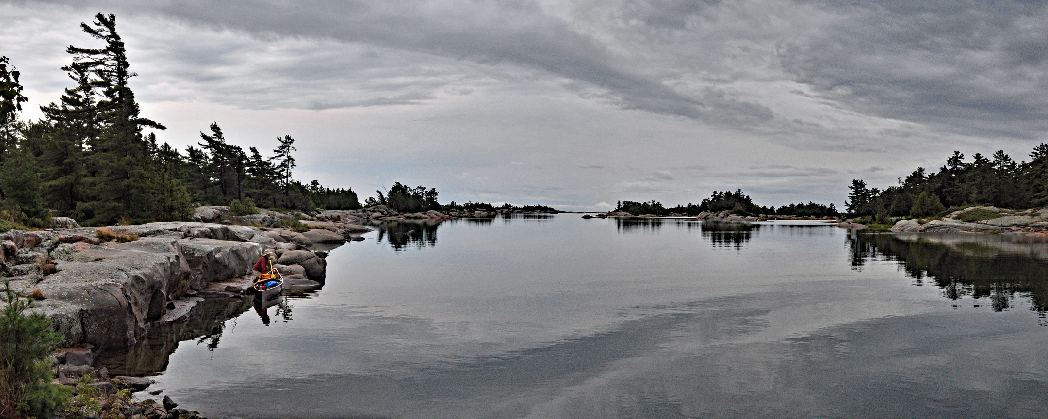 Panorama, grey sky, canoeist setting out