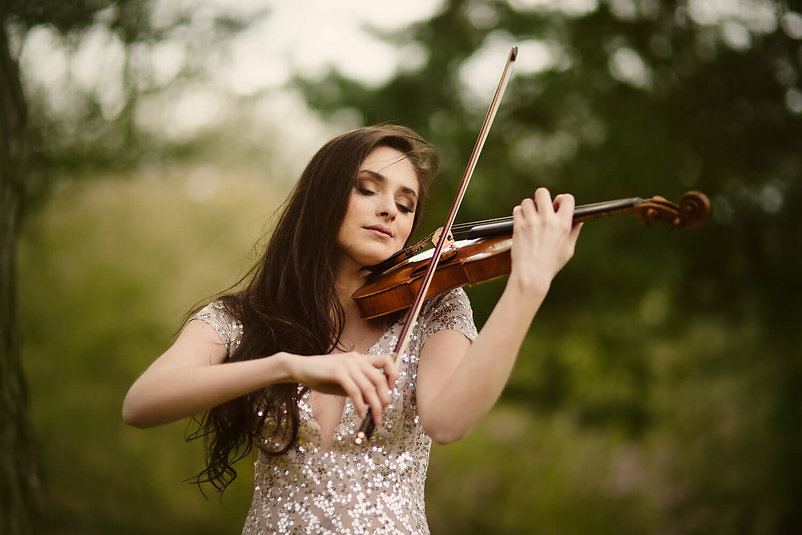 Image of Esther Abrami playing violin outdoors