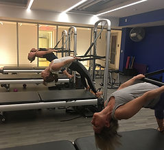 I teach group Pilates classes in New Canaan and duets and private Pilates in Stamford. I love to work on the Reformer, Tower, Cadillac, Pilates Chairs and Barrels. This is a group doing bridging on the Pilates Tower at the New Canaan YMCA.