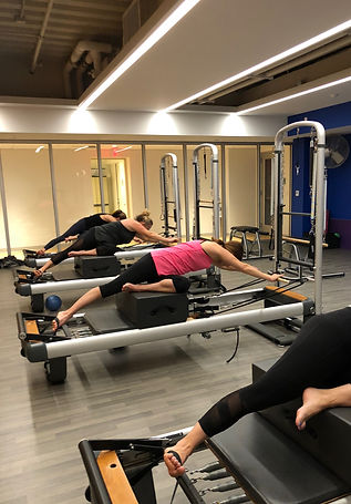 These clients from the New Canaan YMCA love to stretch on the refomer while doing Pilates in a group class.