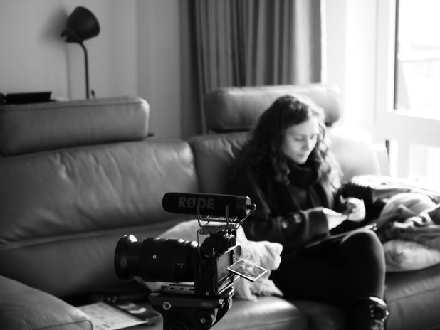 Emily Tucker reading through the script during some down time on-set.