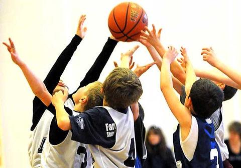 kids fighting for basketball.jpg