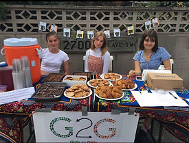 Seavuria Girls to Girls members hosting a bake sale