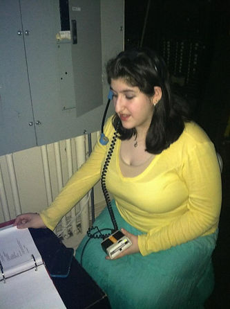 Jackie backstage at a show on headset and in costume at the same time
