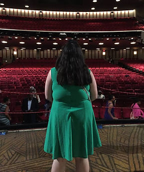 Jackie looking out at the audience from the stage of the Minskoff Theatre on Broadway
