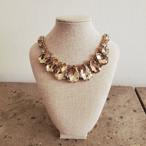Item #16 - Gold colored chain necklace with stones