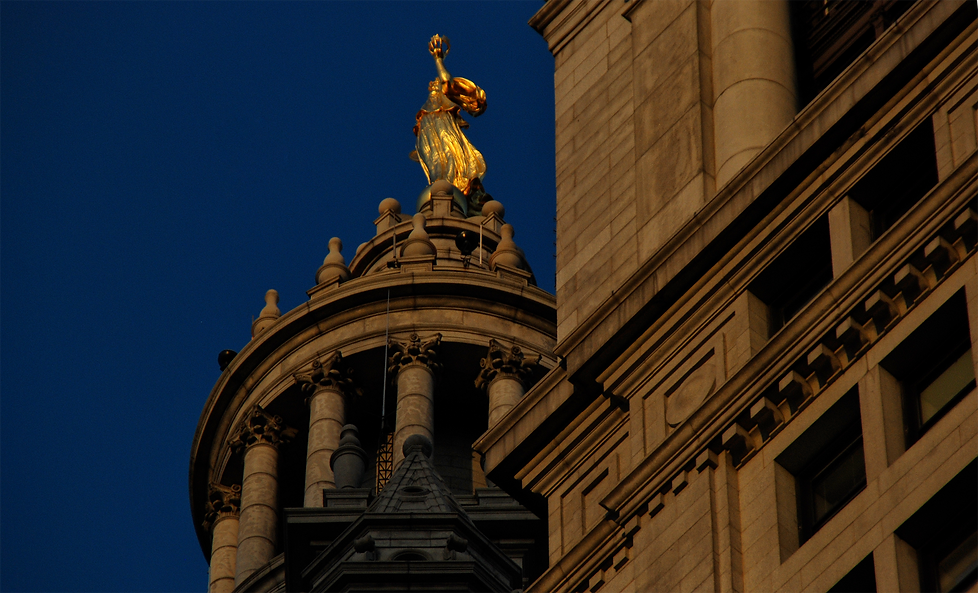 Statue Sunset Lower Manhattan.png