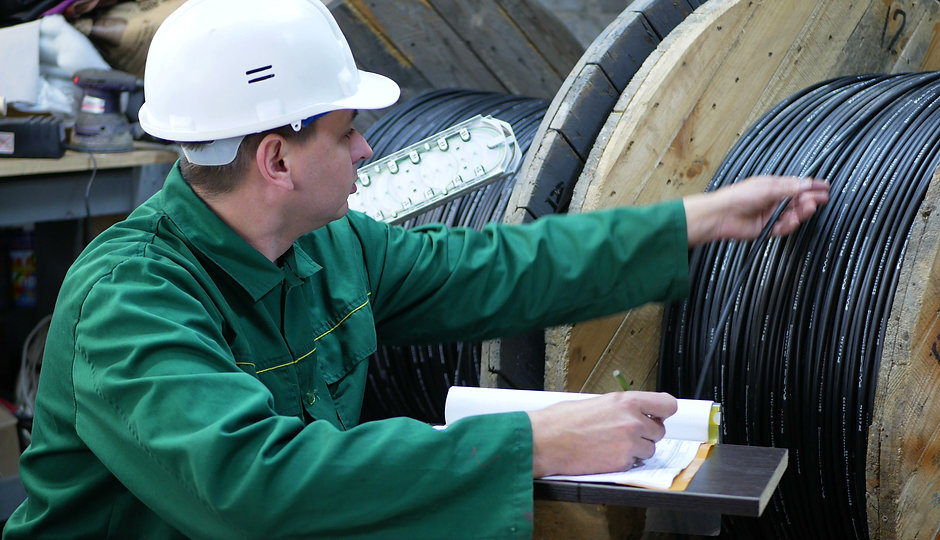 A communications engineer works with an