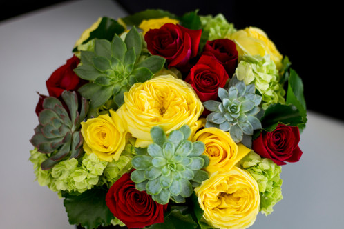 Hat box flower arrangement in red yellow and green colors modern flower arrangement in hat box includes yellow and red mightylinksfo