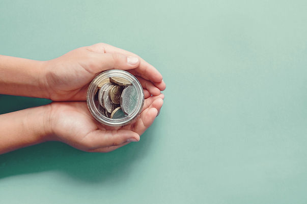 bigstock-Hands-Holding-Money-Jar-Donat-363837478.jpg
