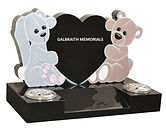 Beautifully shaped and coloured characters cuddle the polished Black granite heart with space for further inscription on the central splay base