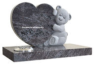Polished Bahama Blue granite heart shaped memorial with a beautifully carved and softly detailed teddy bear
