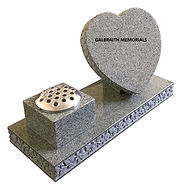 This polished Karin Grey granite heart and vase memorial is charmingly decorated with a deeply carved floral motif to the edges of both the base and the heart, leaving the face free for inscription