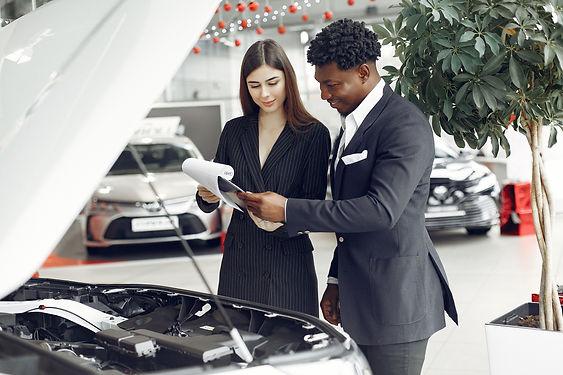happy-stylish-businessman-in-car-showroo