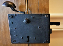 Hand-wrought iron lock.