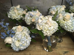 blue hydra and white roses bouquets