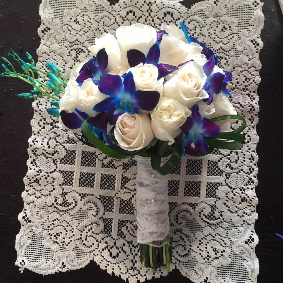 blue orchids and roses bridal
