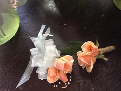 peach spray rose pin on corsage and bout