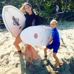 mom surfing with son