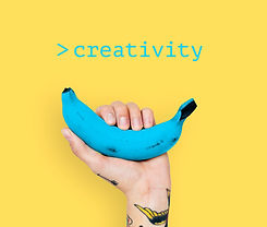 hand-with-tattoo-lifting-blue-banana-wit