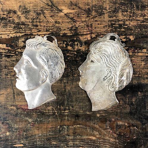 An antique silver Italian Ex voto mans or womenshead.