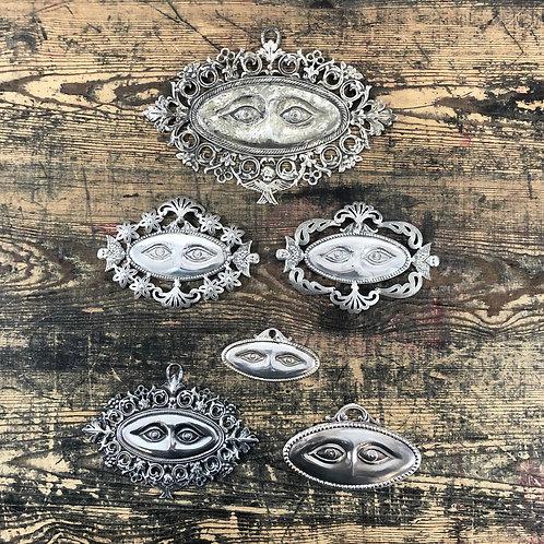 An antique silver Italian Ex voto of eyes