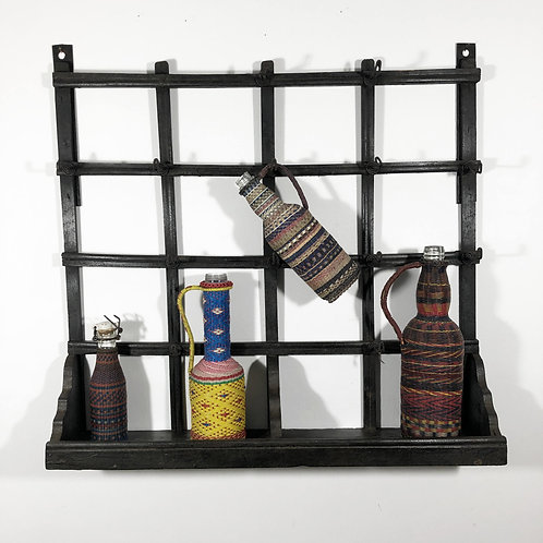 Charming antique folk art cup/bottle rack.