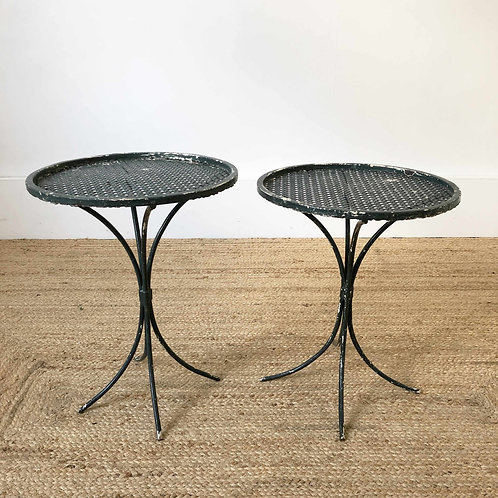 A pair of perforated metal side tables in the style of Mategot