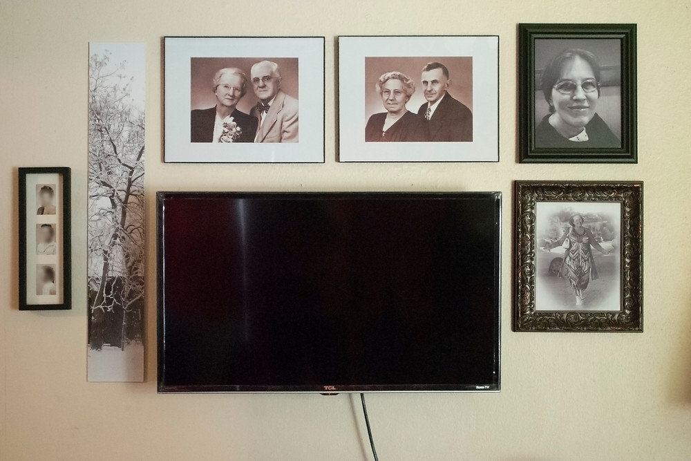 Picture gallery surrounding flat screen TV.