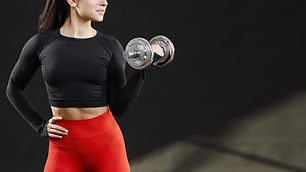 front-view-woman-with-dumbbells-copy-spa