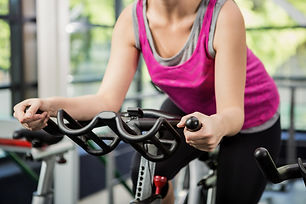woman-working-out-exercise-bike-spinning