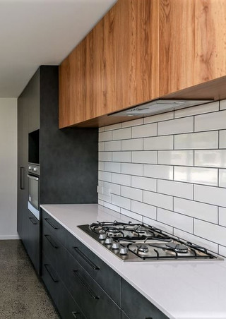 Modern kitchen with timber accents, gas cooktop and subway tiles