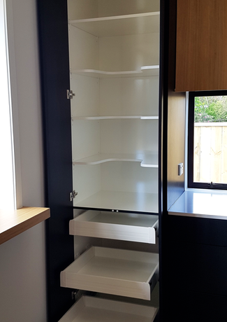 Tall kitchen pantry with pull out drawers