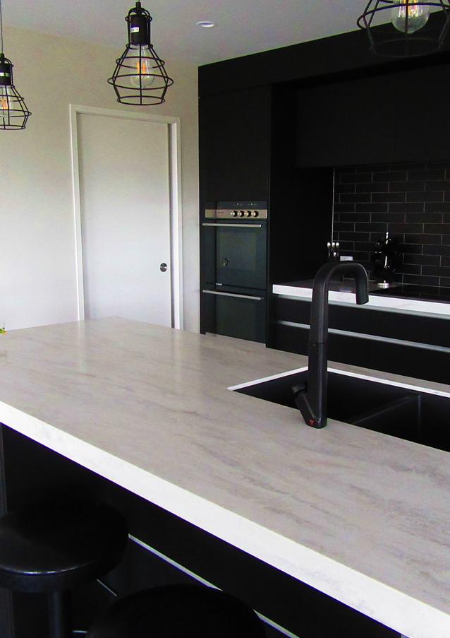 Marbled corian benchtop in sleek black kitchen