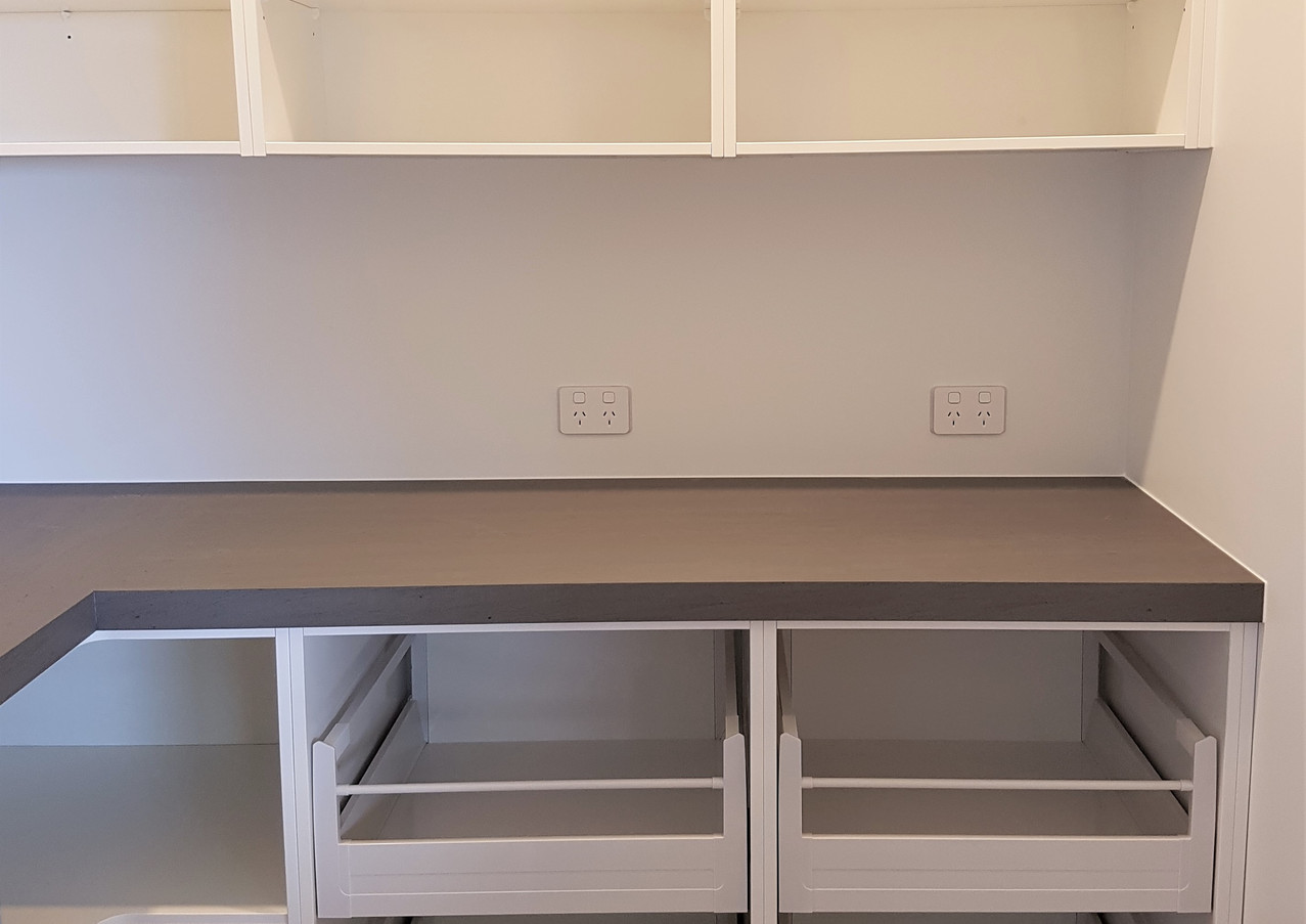 Scullery with internal drawers and open over cupboards