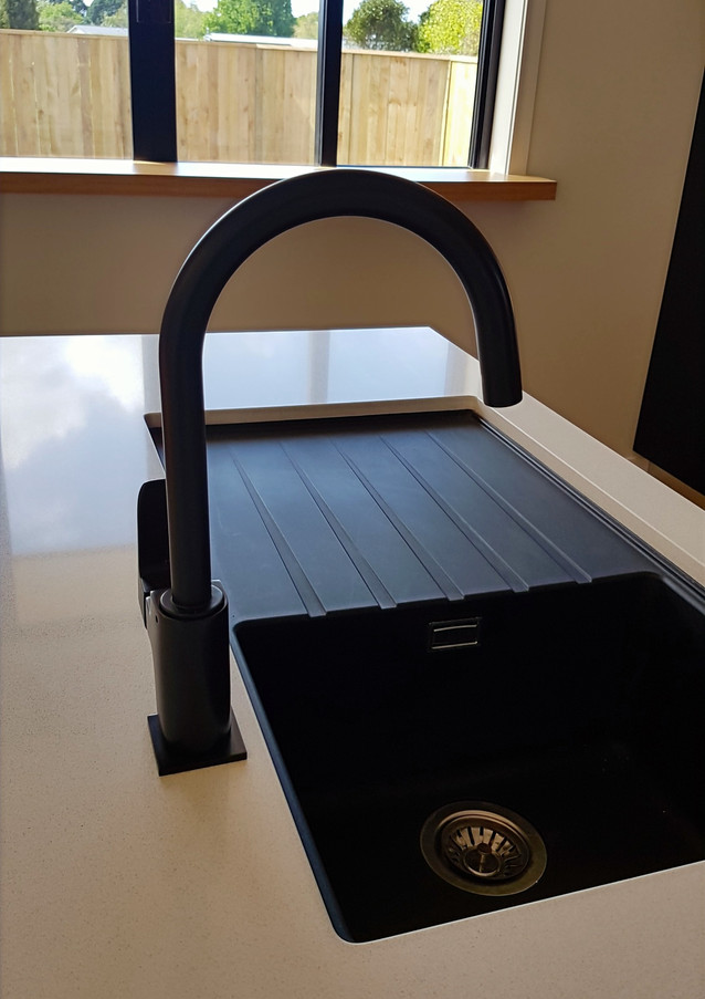 Composite stone sink with stylish black tap