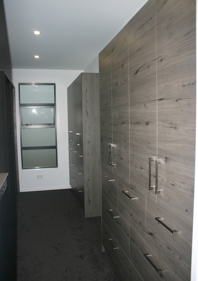 His and hers storage walk in wardrobe