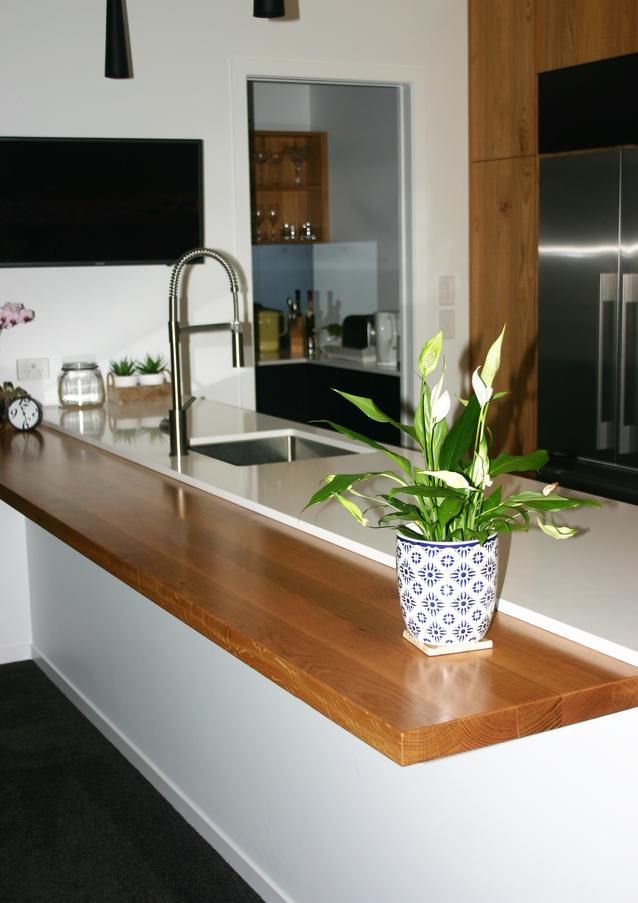 Timber bar leaner on breakfast bar