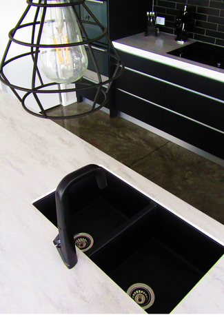 Black granite double sink in oversized kitchen island