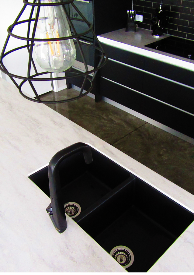 Black granite double sink in oversized kitchen island